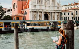 Young woman holding a map in Venice, Italy