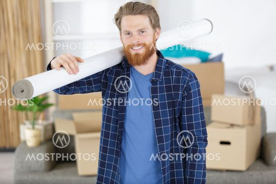 man is carring a wallpaper