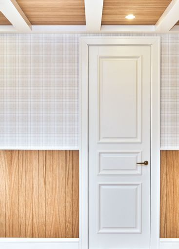 Classic style white door in a room with wooden slats...