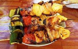 Meat grilled barbecue with spicy sausages on dish ready...