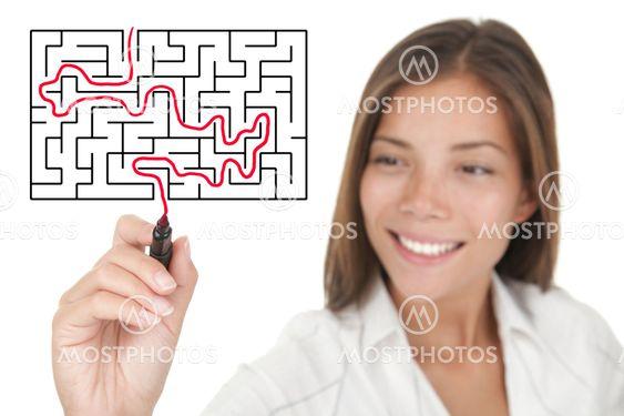 businesswoman solving maze