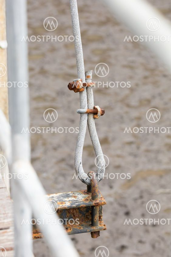Rusty u-bolt on metal sling