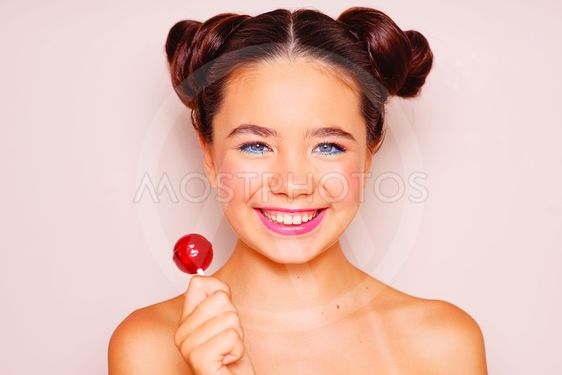 Young girl with sunglasses and lollipop