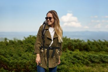 Attractive girl in sunglasses smiling . Traveller is...