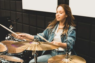 Creativity and music. Young beautiful girl plays the...