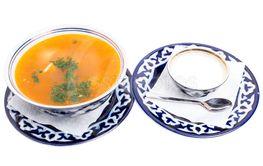 Traditional uzbek dumpling soup with sour cream.