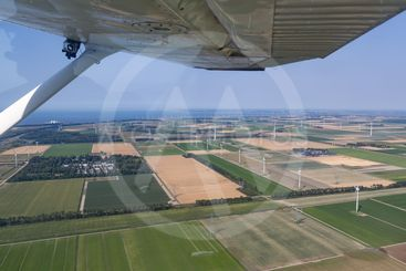 Aerial view Dutch landscape with farmland and wind turbines