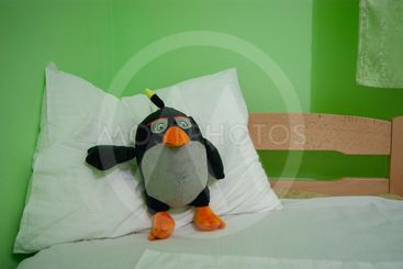 Good night - soft toy penguin on a pillow