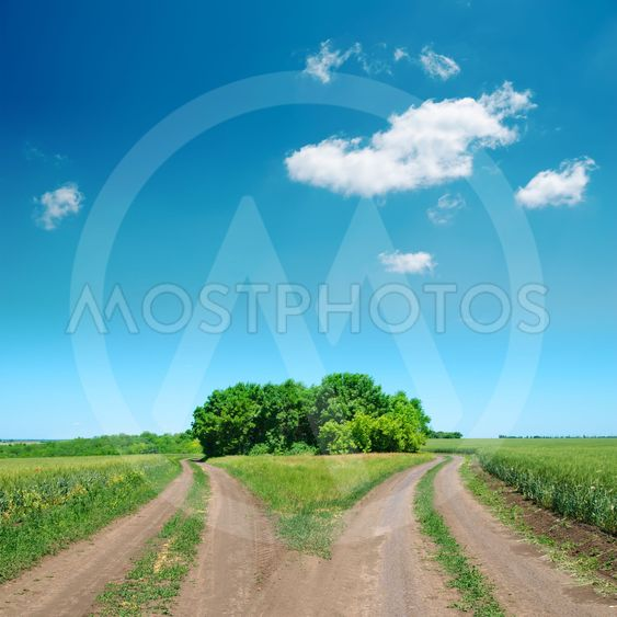 crossing of two rural road and deep blue sky