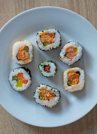Sushi set of maki on a white plate