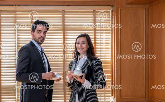 Businessman and businesswoman having a coffee break...