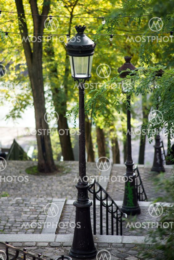 street lights in a paved stairs in montmartre quarter in...