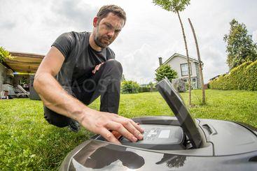Man setting up a robot mower
