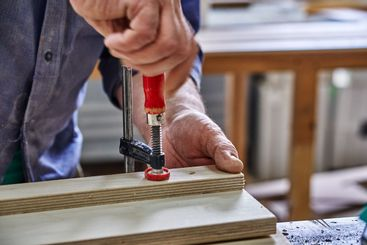 Joinery. Carpenter clamping plywood parts . Furniture...