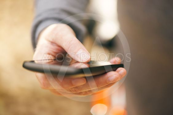 Close up of female hand with mobile smartphone
