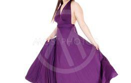 Teenager girl standing in her long burgundy prom dress