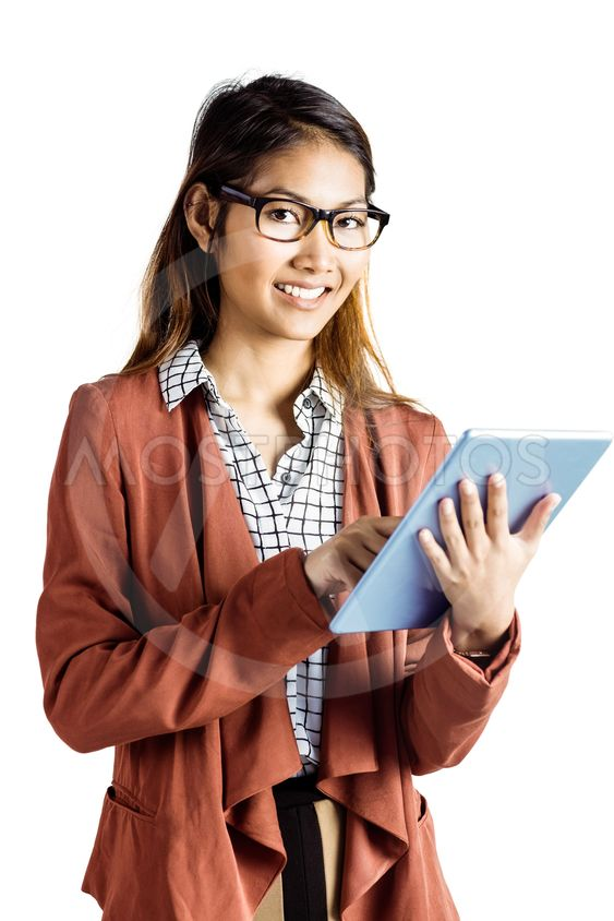 Smiling businesswoman with eyeglasses using a tablet