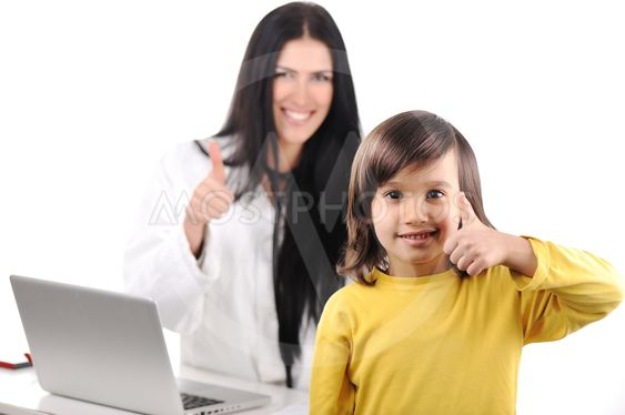 Young female doctor examining little cute happy child...