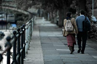 Couple Walking Beside Boats