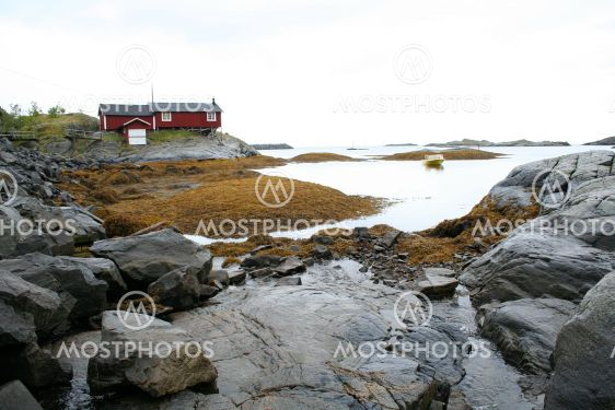 bay with rocks and house