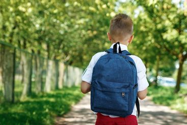 Back to school. A boy from an elementary school with a...