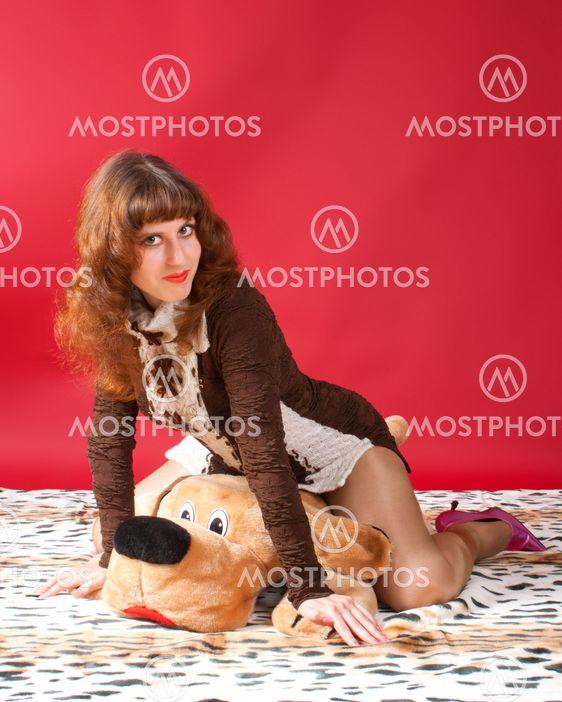 Young woman embracing bear