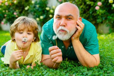Happy grandfather and grandson relaxing together. Family...