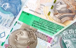 Polish tax information on a background of banknotes