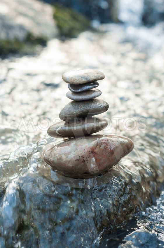 stone balance on rock in the river
