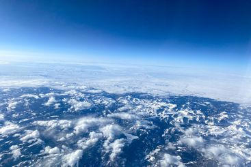 An aerial view from an airplane window of mountains,...