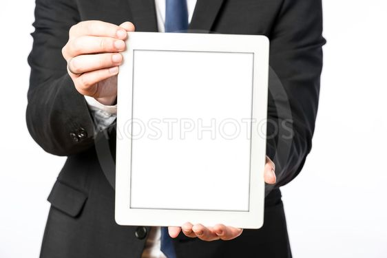 Business man shows his blank tablet computer