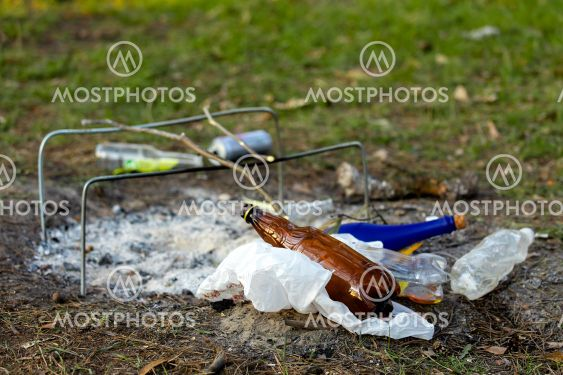 A pile of garbage in the forest park near the campfire...
