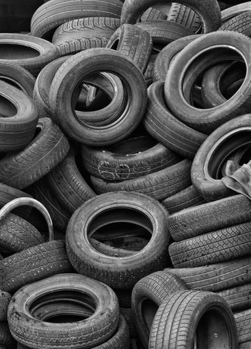 Stack of old tyres at waste disposal