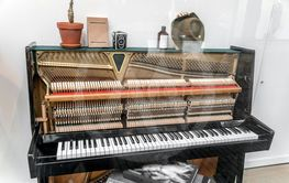 piano with various items on top