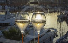 Two champagne flute glasses sunset