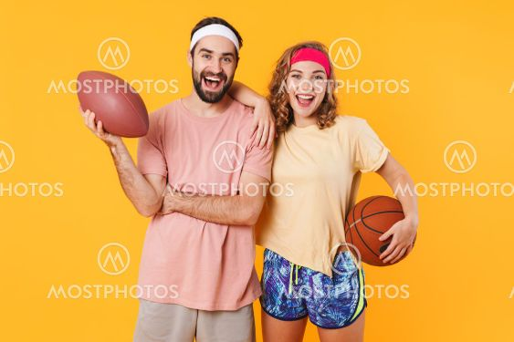 Portrait of young happy caucasian fitness couple holding...