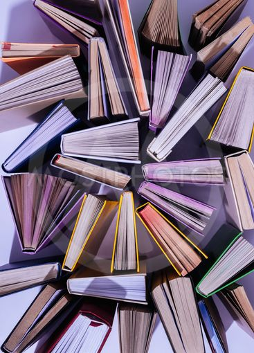 elevated view of scattered stack of books on table
