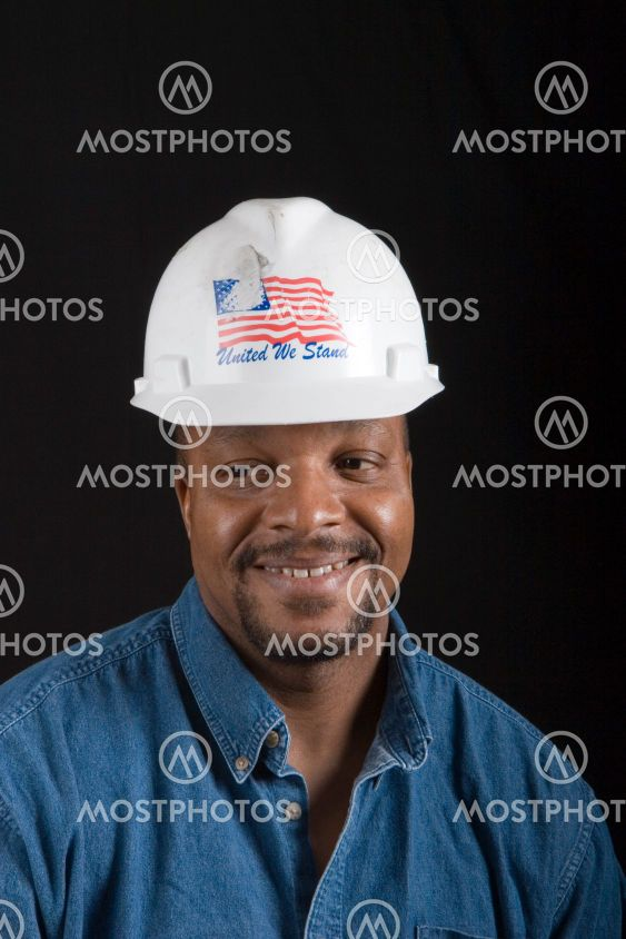 Construction Worker Smiling Looking Away