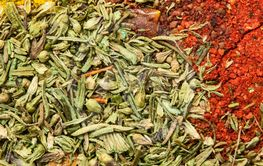 Wide variety spices and herbs with empty space for text...