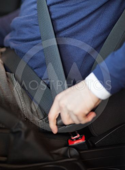 Man fastening his seatbelt