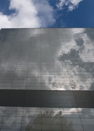 Glass wall with sky