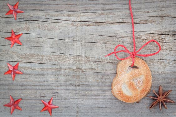 Christmas cookies and star anise. On textured wood.