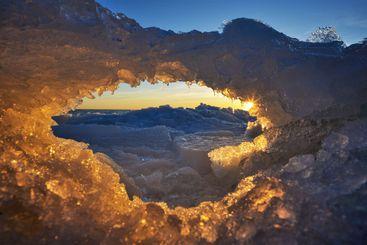 Sunset over ice arch in Näsbokrok Naturreservat, Sweden