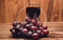 Glass filled with Red Grape Juice and fruits