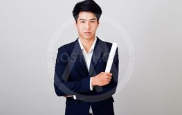 portrait young of  businessman on gray