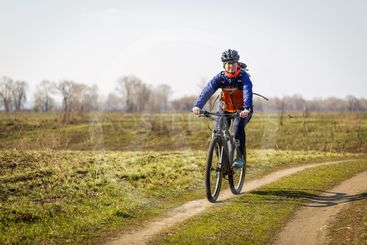 woman cyclist riding a bicycle in the field
