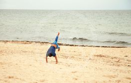 Acrobatics stunts on the sand. The beach of Sousse, Tunisia