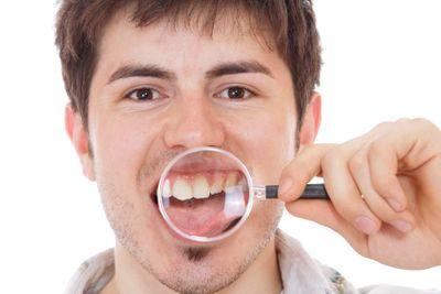 Man examining his teeth