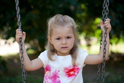 Little happy girl in summer park