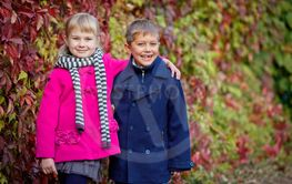 Children walking in beautiful autumn park on warm sunny...